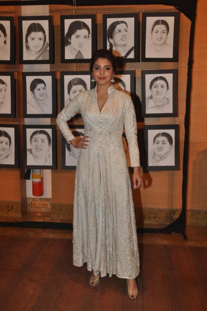 Actress Anushka Sharma in golden heels