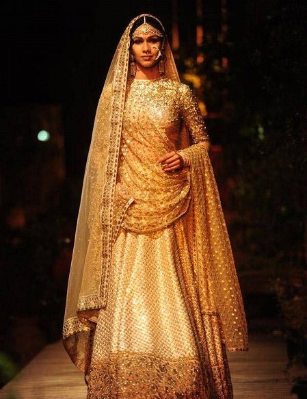 A model in Sabhyasachi Golden Lehnga