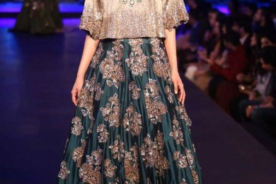 Teal green embroidered Lehnga Skirt and loose crop top from Manish Malhotra