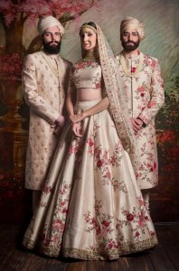 Matching Floral ensembles for bride and groom-