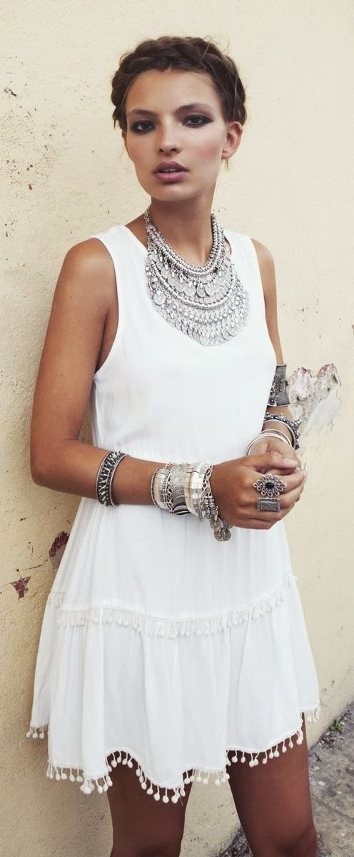 White dress with silver jewelery