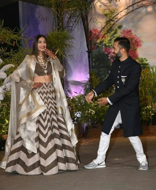 Anand Ahuja in white sneakers on his reception