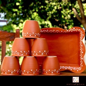 Earthen tea cups and plate
