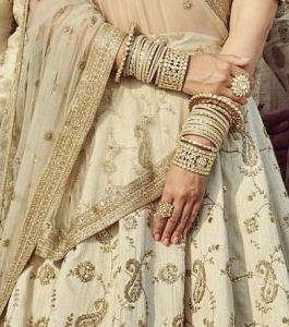 The gold kara or bangle look for the brides
