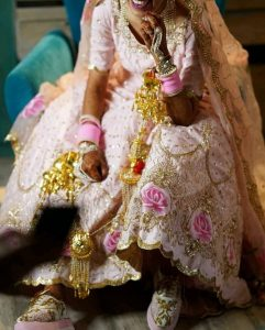Brides wearing sneakers with lehnga
