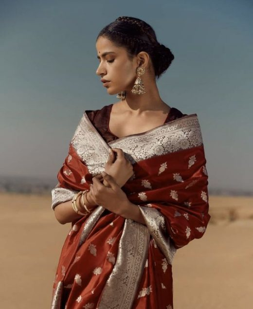 Wear earrings with the saree and give neckpiece a miss