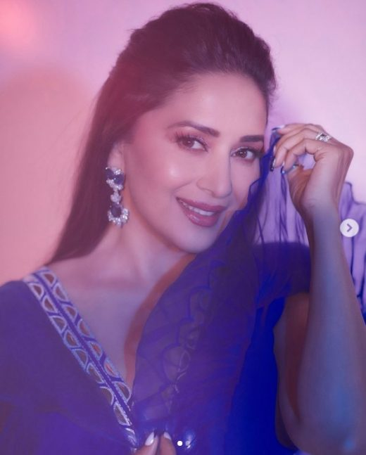 Madhuri Dixit looks surreal in a blue modern top and embroidered skirt
